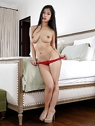Asian babe Jade Kush removes her red lingerie to show her big lips creamy pussy