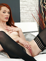 Beautiful red haired finger fucks her wet pussy
