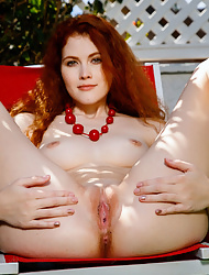 Beauty redhead Heidi Romanova in the backyard posing nude