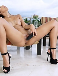 Big bottomed latina babe Demi Lopez rides a black toy