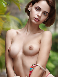 Brunette Ariela showing skinny body in bikini and her tits outdoor