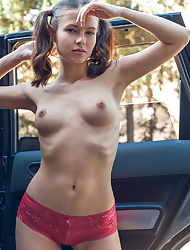 Brunette babe Hilary in pigtails displaying her pink panties in car