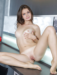 Brunette babe Varya M posing in panties & baring her sexy ass