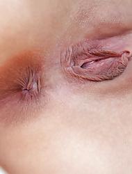 Brunette cutie Lucretia K strips nude for you