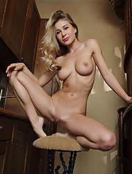Candice Brielle aka Candy D with long legs undressing to spread naked in the kitchen