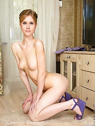 Cock hungry coed shows off her long legs and soft shaved pussy