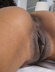 Curly ebony Demi Sutra with juicy bubble ass rides her dildo
