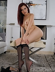 Cute redhead Sabina Rouge wears nylon pantyhose and exposes her shaved coochie