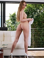 Daisy Stone is using a sex toy to drill her perfectly shaved pussy