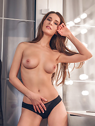 Dark haired solo babe Elina Mikki striptease her sexy lingerie seductively