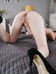 Elegant solo babe Mia Evans undressing and masturbating in bed
