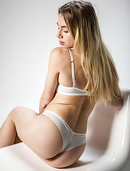 Erotic blonde Alecia Fox in sexy white lingerie and bare perfect pussy