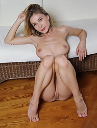 Erotic Candy D reveals perfect tits and spreads slender legs