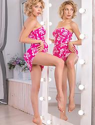 Erotic girl Eva Tali sheds pink dress to flaunt her bald twat