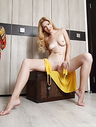 Genevieve Gandi poses in front of the camera baring her beautiful body and trimmed pussy