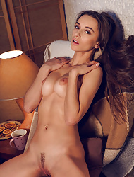 Glamour brunette Gloria Sol strips off her sexy lingerie to expose her tanned body