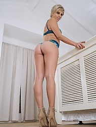 Gorgeous blonde Makenna Blue slides her lingerie and masturbating solo