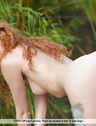 Heidi Romanova peels off her bikini to pose naked in the forest
