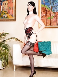 Long legged tall brunette model Alex posing in stockings and heels