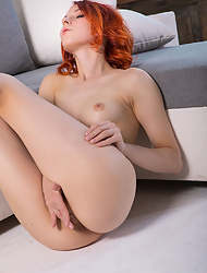 Redhead Elin Holm rubbing her sweet clit with fingers