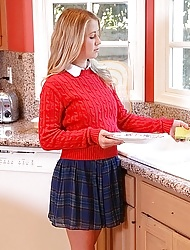 Schoolgirl in a cute red sweater and pleated skirt fucks a big dick guy in her bedroom