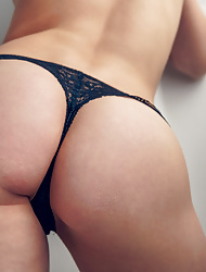 Sensual babe Clarice in glasses frees her tight butt for us
