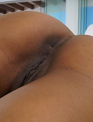 Sexy ebony Demi Sutra warms up with favorite sex toy