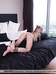 Skinny babe Eva Gold with small tits in thigh high stockings