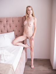 Skinny blonde babe Eva Gold spreading tight slit in her bedroom