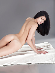 Skinny girl Stefany G flaunting round booty to pose nude
