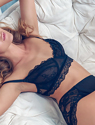 Slim blonde model Sybil A in black lingerie demonstrates her hot ass