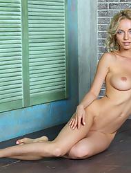 Smiling blue eyed girl Annabell modelling totally naked