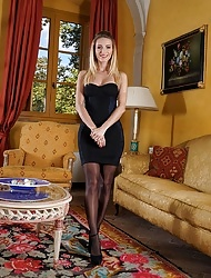 Stunning solo model Cara Mell posing in black nylons