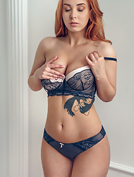 Super hot redhead Lil Vos disrobing and playing with her pussy