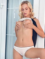 Tanned blonde Vika P fingering her amazing pink slit
