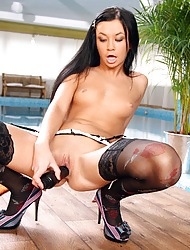Teen wearing stockings masturbates with black dildo