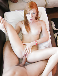 Tiny little redhead stretches her pussy with a vibrator to get it ready for a cock