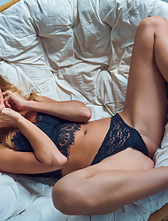 Ukrainian hottie Cara Mell seductively strips her black lingerie