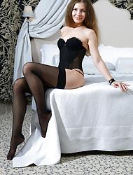 Vivian posing in a black bustier