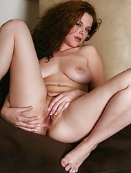 With her lovely curls and big tits she is every man's dream